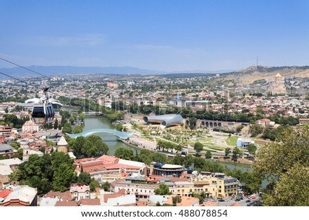 Tbilisi, Georgia - August 1, 2015: You can see oldest disctrict Kala of Tblisi. This is a view from Narikala hill. There is a European Youth Summer Olympic Festival 2015 advertising on cable cars.