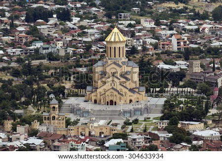 TBILISI, GEORGIA - JULY 18: Areal view of the Sameba (Holy Trinity) cathedral on July 18, 2015 in Tbilisi.  It is the main cathedral of the Georgian Orthodox Church. - stock photo