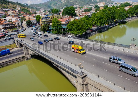 TBILISI, GEORGIA - JULY 18, 2014: Bridge over the river  of Tbilisi, Georgia. Tbilisi is the capital and the largest city of Geogia with 1,5 mln people population