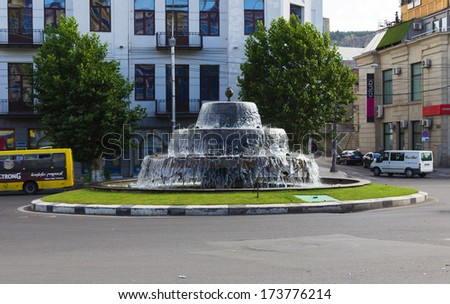 "TBILISI, GEORGIA - JULY 03, 2013: Fountain in the square ""Avlabari"". The city Tbilisi has a population of 1.5 million people"