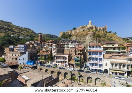 TBILISI, GEORGIA - JULY 18, 2015: View of the georgian capital's downtown, behind the medieval Narikala fortress.