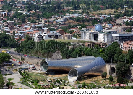 TBILISI, GEORGIA - JUNE 13, 2015: Aerial view of the concert hall and Presidential palace in the capital of Georgia Tbilisi from Narikala fortress - stock photo