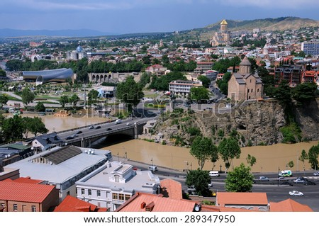 TBILISI, GEORGIA - JUNE 13, 2015: Aerial view of the concert hall, Trinity church and Metekhi church from Narikala fortress less than 12 hours before the tragic flood on June 14 - stock photo