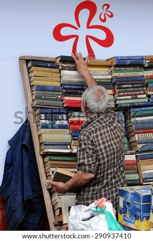TBILISI, GEORGIA - JUNE 13, 2015: Secondhand bookseller and second-hand books in the street of the city - stock photo