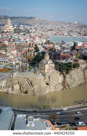 TBILISI, GEORGIA - MARCH 5, 2016: Top view of the river and the Church in the central part of the city.