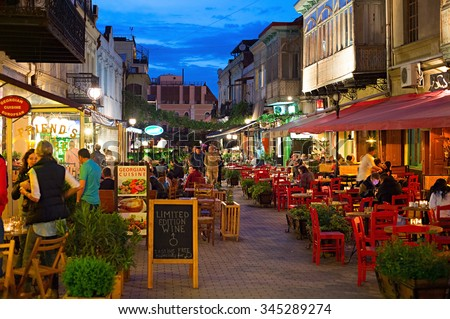 TBILISI, GEORGIA - MAY 02, 2015: People at restaurant in the Old Town of Tbilisi. Tbiisi is the capital of Georgia and the largest city in Georgia - stock photo