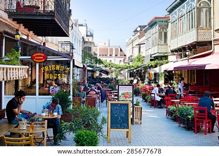 TBILISI, GEORGIA - MAY 02, 2015: People at restaurant in the Old Town of Tbilisi. Tbilisi is the capital of Georgia and the largest city in Georgia - stock photo
