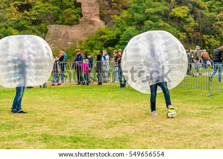 TBILISI, GEORGIA, October 16, 2016: People  in the inflatable balls play bamperbol