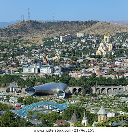 Tbilisi, Georgia. View of the Holy Trinity Cathedral, Building of Presidential Administration, Concert hall and pedestrian Bridge of Peace.