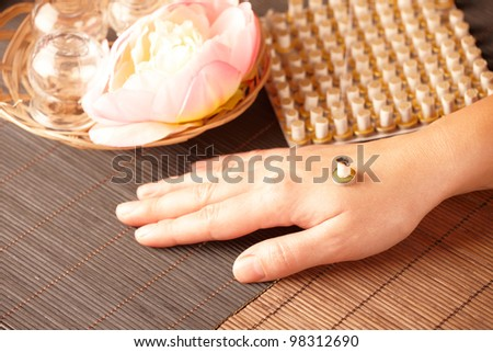 TCM Traditional Chinese Medicine. Mini moxa stick therapy, natural herbs in glass jars in background - stock photo