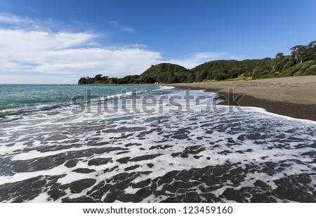 Te Kaha beach/ on New Zealand's East-cape - stock photo