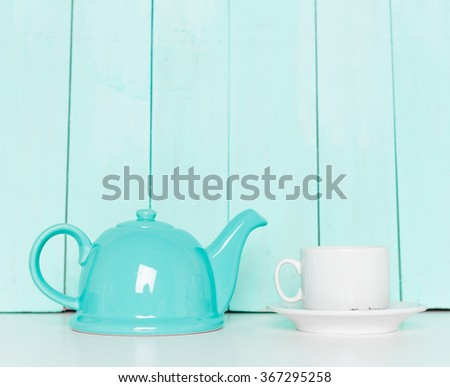 Tea accessories on pastel wooden background