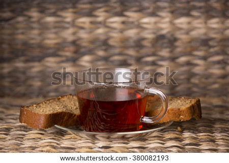 Tea and cake on wooden table in front of a wooden background
