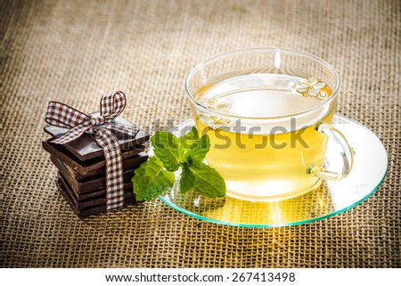 Tea and chocolate nicely served with rustic. - stock photo