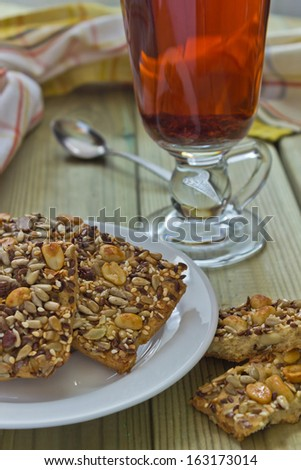 tea and cookies with nuts on a table