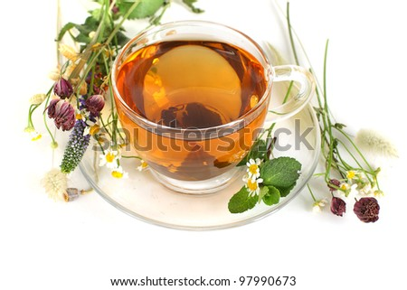 Tea and flowers on white background