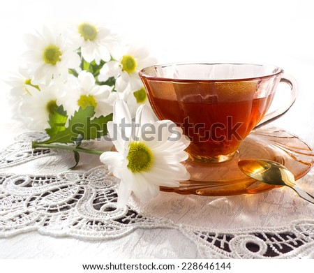 Tea and fresh chamomile flowers with copy space