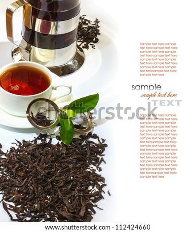 Tea and tea accessories on a background of antique furniture - stock photo
