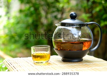 Tea and teapot and tree background - stock photo