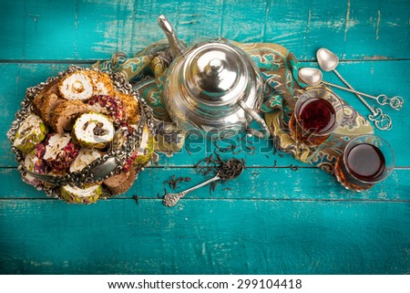 Tea and turkish delight on wooden background - stock photo