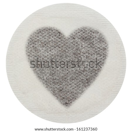 Tea bag with tea in the shape of a heart - Isolated on white with clipping path - stock photo