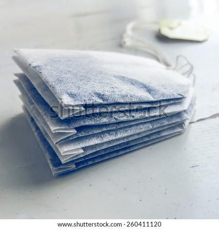 Tea bags on white table - stock photo