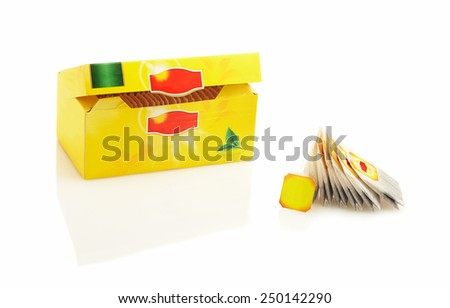 Tea bags packed in a yellow box. Isolated on white background - stock photo