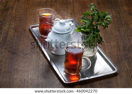 tea break consist of two cups of tea, tea pot,mint in cold water and its traditional way of serving tea in egypt.