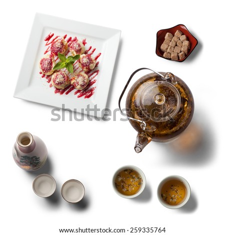Tea ceremony with a tasty dessert, view from above, isolated on white - stock photo