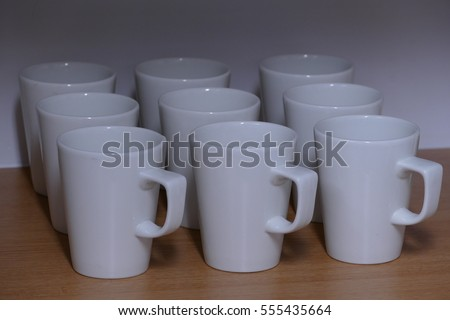 office space coffee mug. Tea / Coffee Mugs Ordered On A Shelf. Typical Refreshment Advertisement For Meeting Room, Office Space Mug