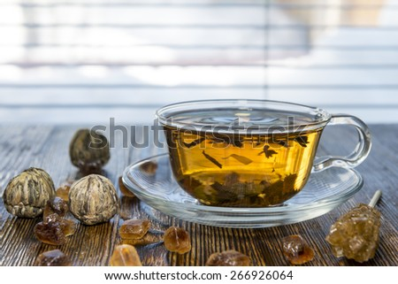 tea composition on a wooden background - stock photo