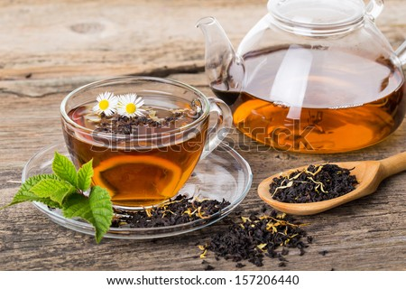 Tea composition with mint leaf on wooden palette - stock photo