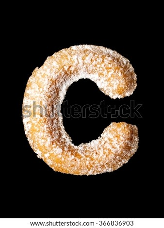 Tea cookie with powder sugar, C letter of the alphabet