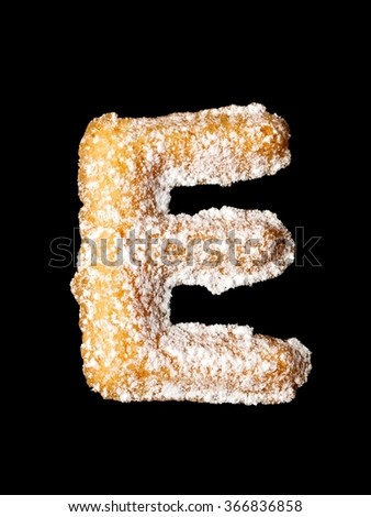 Tea cookie with powder sugar, E letter of the alphabet - stock photo