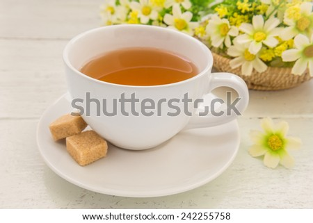 Tea cup and brown sugar cubes