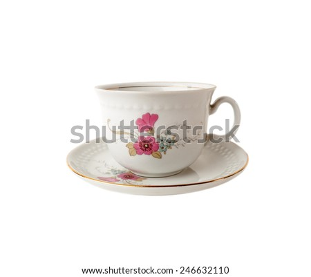 Tea cup and saucer of porcelain with floral patterns isolated over white - stock photo