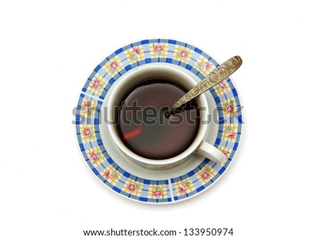 tea cup and saucer with a drink, a spoon, top view, photo on white background.