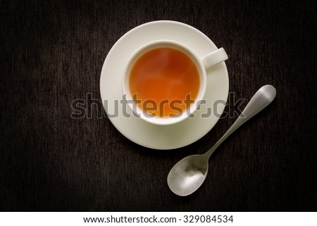 Tea Cup on Black Background - stock photo