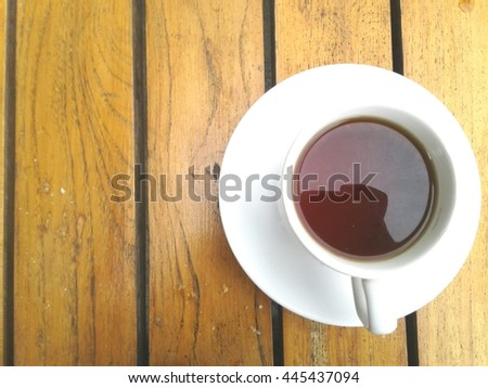 Tea cup on the wooden table