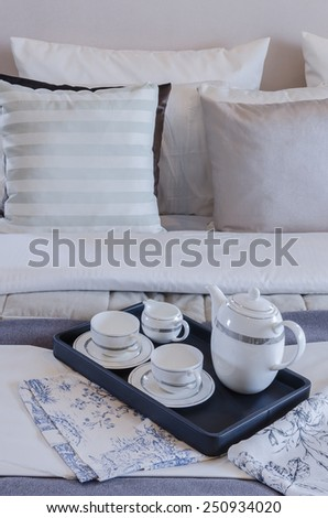 tea cup set on black tray in bedroom at home - stock photo