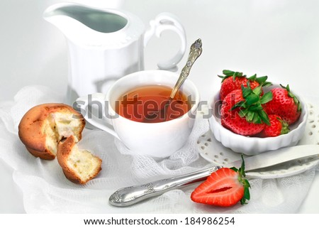 Tea cup with cake  and strawberry on the plate - stock photo