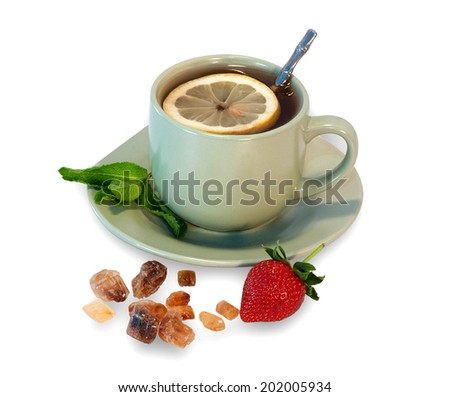 Tea cup with lemon, mint, cane sugar strowberry isolated on white background - stock photo