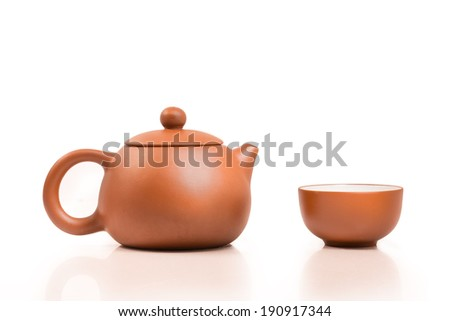 Tea cup with teapot  isolated on white background - stock photo