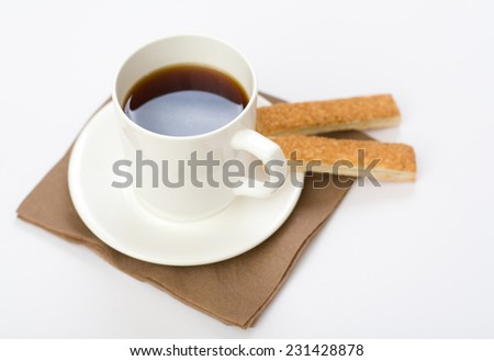 Tea cup with the spoon and the cookies on the dish - stock photo