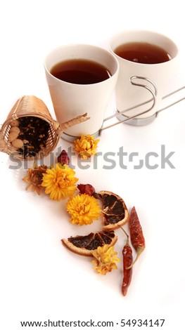 Tea cups with lemon and daisy on the table