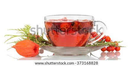 Tea from the hips in a cup isolated on white background