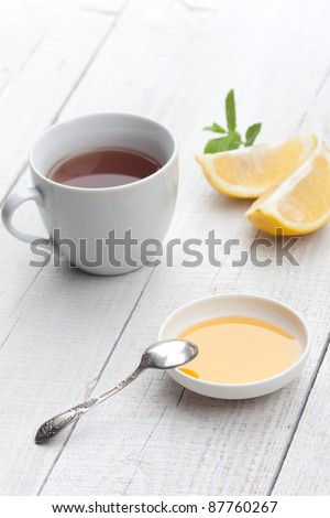 Tea & honey - stock photo