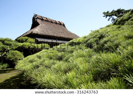 Tea house in a beautiful japanese garden