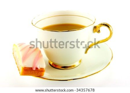 Tea in a cup and saucer with pink slice of cake on a white background