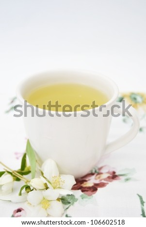Tea in a white cup in a romantic setting